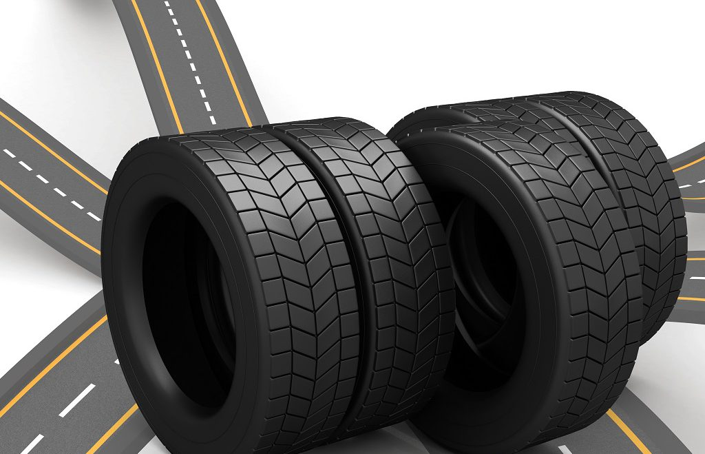 Digital composite image of tyres arranged against white background